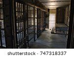 prison cells in an old jail | Shutterstock . vector #747318337