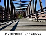 wooden bridge with iron rigging ... | Shutterstock . vector #747320923