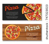 realistic pizza flyer on wooden ... | Shutterstock .eps vector #747323023