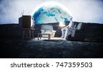 funny alien watching tv on the...   Shutterstock . vector #747359503
