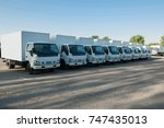trucks stand in a row in the... | Shutterstock . vector #747435013