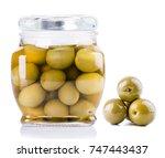 olive bottle and green olives | Shutterstock . vector #747443437