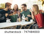 group of four friends having... | Shutterstock . vector #747484003