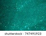 blurry turquoise glitter bokeh... | Shutterstock . vector #747491923