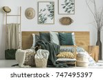white handmade knot cushion in... | Shutterstock . vector #747495397