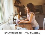 child girl helps mother at home ... | Shutterstock . vector #747502867
