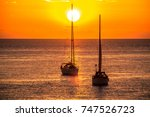 sailboats in the sea at sunset | Shutterstock . vector #747526723