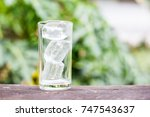 ice in the glass on table with... | Shutterstock . vector #747543637