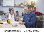 cheerful senior couple having... | Shutterstock . vector #747571957