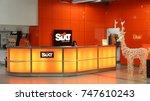 Small photo of HAHN, GERMANY - DECEMBER 7, 2016: Sixt car rental employee waits for customers at Frankfurt Hahn Airport in Germany. Sixt has some 4,000 locations in over 105 countries.