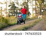 running mother with child in... | Shutterstock . vector #747633523
