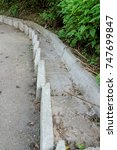 Small photo of Concrete step flow for the flow of rainwater along a very steep asphalt walkway running down the hill