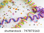 streamers and confetti on white ... | Shutterstock . vector #747873163