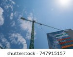 tall crane working on skanska... | Shutterstock . vector #747915157