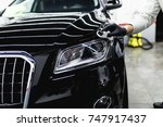 worker cleaning car   car... | Shutterstock . vector #747917437