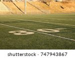 Small photo of 30 yards to the goal. Measuring each yard gained.