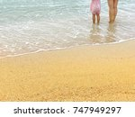mother and daughter standing on ... | Shutterstock . vector #747949297