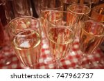 many glasses of champagne at... | Shutterstock . vector #747962737