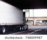 a white big rig semi truck with