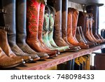 Cowboys Boots On A Shelf In A...