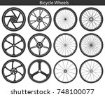 bicycle wheels with different... | Shutterstock .eps vector #748100077