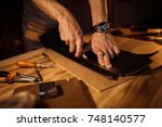 working process of the leather... | Shutterstock . vector #748140577