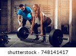 young woman doing hard exercise ... | Shutterstock . vector #748141417
