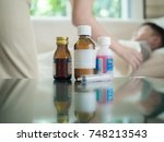 baby medicine with sick child... | Shutterstock . vector #748213543