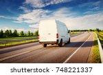 asphalt road on dandelion field ... | Shutterstock . vector #748221337