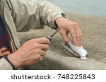 fisherman hollowing out a... | Shutterstock . vector #748225843