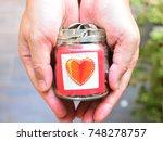 coins in bottle glass for...   Shutterstock . vector #748278757