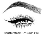woman eye and perfect eyebrows... | Shutterstock .eps vector #748334143