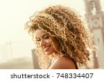 gorgeous and happy woman... | Shutterstock . vector #748334407