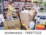 female forklift user in shop... | Shutterstock . vector #748377223
