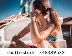 red haired girl on a yacht