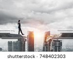 businessman walking blindfolded ... | Shutterstock . vector #748402303