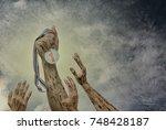 champion  hand holding a winner ... | Shutterstock . vector #748428187