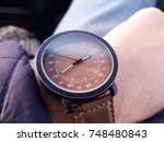wrist watch on wrist of young... | Shutterstock . vector #748480843