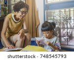 asian granddaughter read for... | Shutterstock . vector #748545793