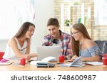 young students studying indoors | Shutterstock . vector #748600987