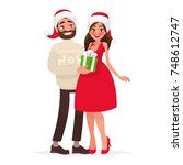man gives a woman a gift for... | Shutterstock .eps vector #748612747