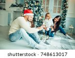 happy family playing with... | Shutterstock . vector #748613017