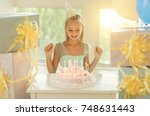 little birthday girl blowing... | Shutterstock . vector #748631443