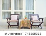 wooden chair standing on the... | Shutterstock . vector #748665313