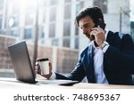 man with laptop and smartphone... | Shutterstock . vector #748695367