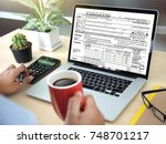 time for taxes planning money... | Shutterstock . vector #748701217