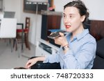 woman talking on the phone with ...   Shutterstock . vector #748720333