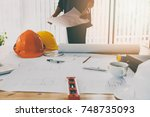 confident team of architect... | Shutterstock . vector #748735093