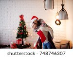 adorable playful love couple... | Shutterstock . vector #748746307