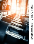 rows of dumbbells in the gym... | Shutterstock . vector #748777453